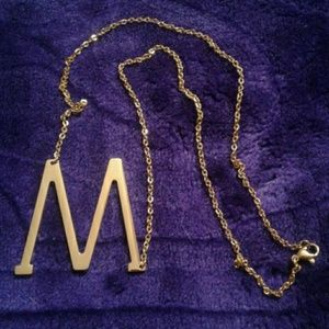 """M"" gold necklace"